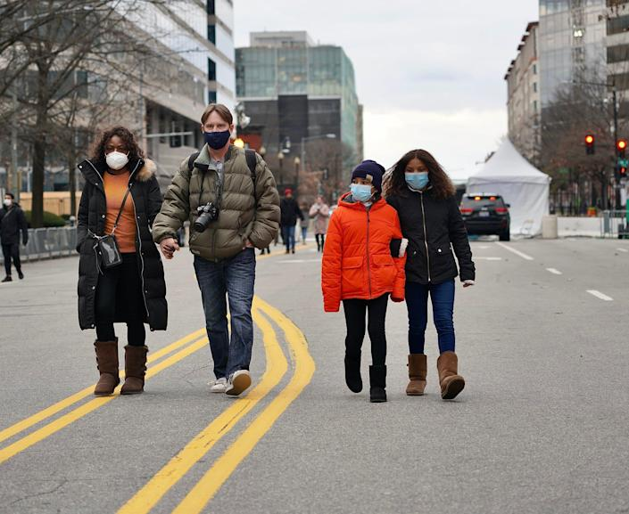 Anna Havlin, 10, right, and her family came to Washington from Brazil for the inauguration of President-elect Joe Biden. The nation's capital is on high alert against threats after a deadly pro-Donald Trump insurrection at the U.S. Capitol.