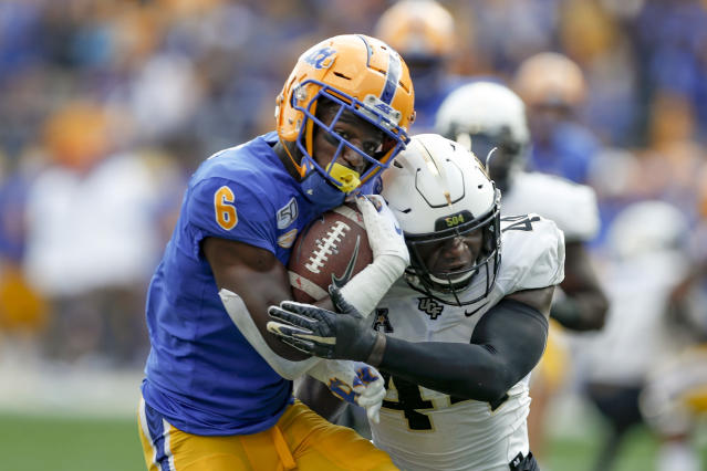 Pittsburgh wide receiver Aaron Mathews (6) tries to get away from Central Florida linebacker Nate Evans (44) after making a catch during the first half of an NCAA college football game, Saturday, Sept. 21, 2019, in Pittsburgh. (AP Photo/Keith Srakocic)