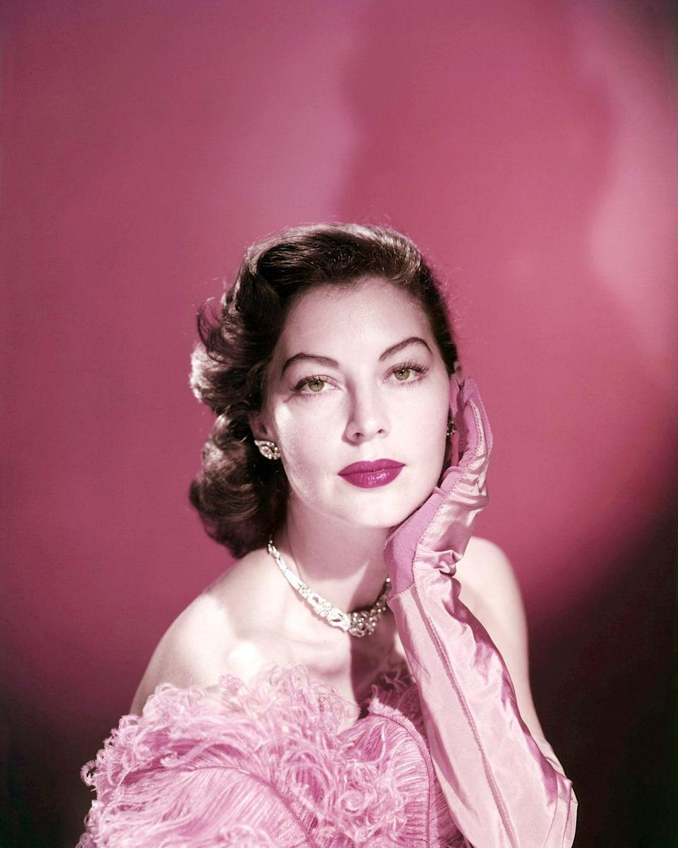 <p>Here, Gardner's stunning beauty is on full display: perfectly coifed hair, a raspberry lip, a pink evening gown, gloves, and diamond jewels all glittering together. <br></p>