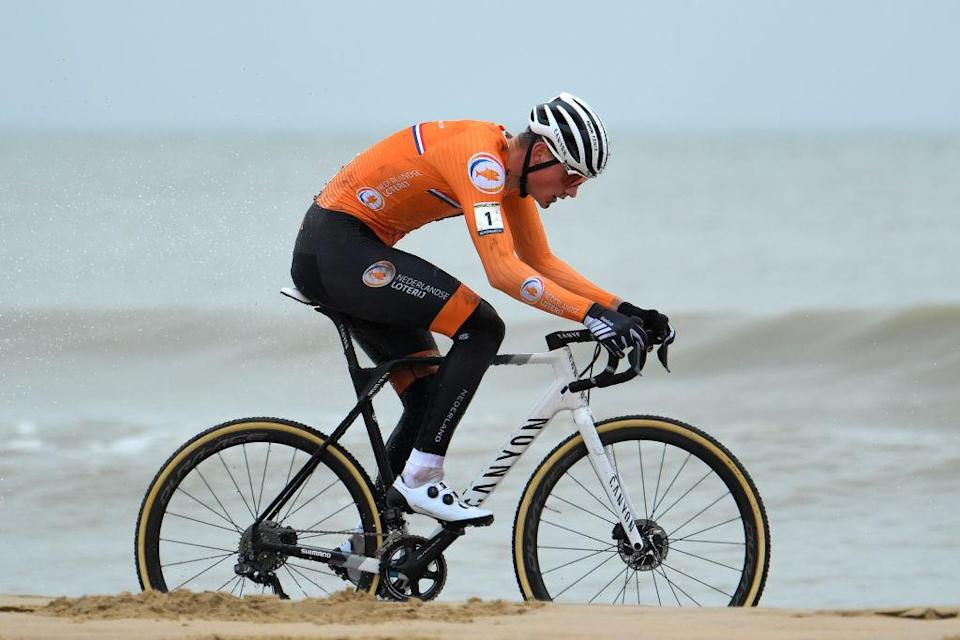OOSTENDE BELGIUM JANUARY 31 Mathieu Van Der Poel of The Netherlands Sand Sea during the 72nd UCI CycloCross World Championships Oostende 2021 Men Elite UCICX CXWorldCup Ostend2021 CX on January 31 2021 in Oostende Belgium Photo by Luc ClaessenGetty Images