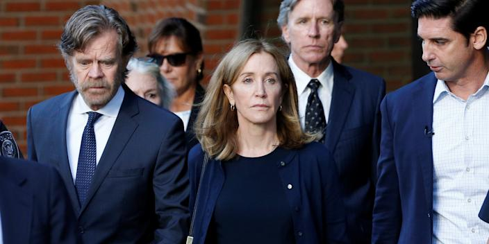 Actress Felicity Huffman and husband William H. Macy leave the federal courthouse in Boston.