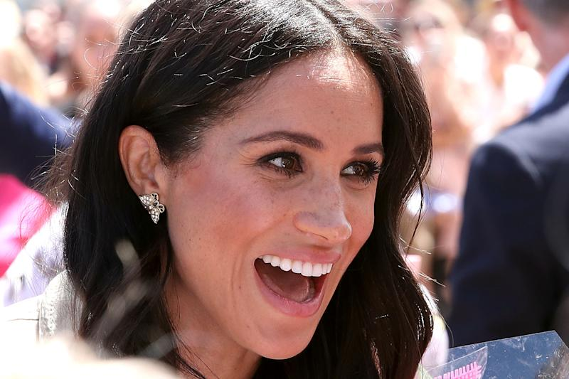 Meghan wore Princess Diana's earrings on the couples royal tour of Sydney, Australia. [Photo: Getty Images]