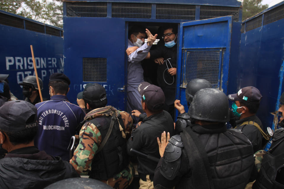 Police arrest doctors demanding facilities and prevention kits to attend to coronavirus patients, in Quetta, Pakistan, Monday, April 6, 2020. The government imposed a nationwide lockdown to try to contain the outbreak of the virus. (AP Photo/Arshad Butt)