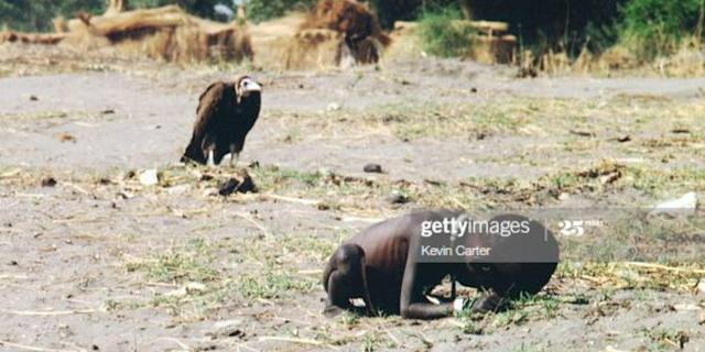 A vulture watches a starving child on March 1, 1993 in Sudan. Photo by Kevin Carter/Sygma/Sygma via Getty Images