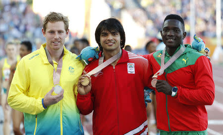 Athletics - Gold Coast 2018 Commonwealth Games - Men's Javelin Throw - Medal Ceremony - Carrara Stadium - Gold Coast, Australia - April 14, 2018. Gold medalist Neeraj Chopra of India, silver medalist Hamish Peacock of Australia and bronze medalist Anderson Peters of Grenada on the podium. REUTERS/Paul Childs
