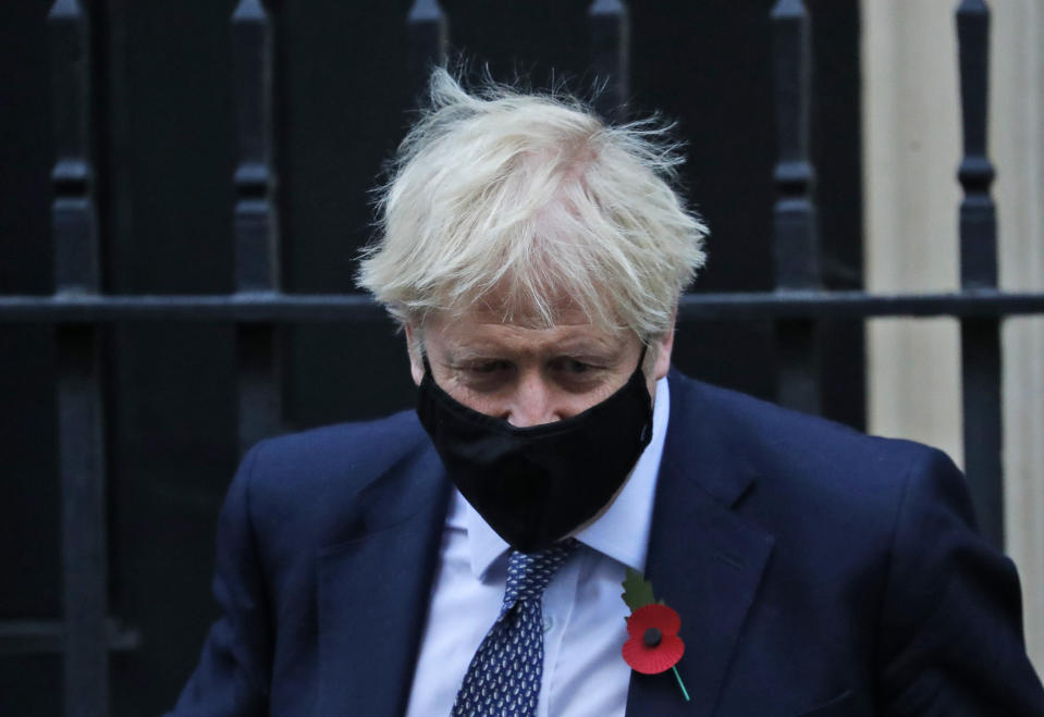Britain's Prime Boris Johnson leaves 10 Downing Street to attend the weekly Prime Minister's Questions session in parliament in London, Wednesday, Nov. 4, 2020. (AP Photo/Frank Augstein)