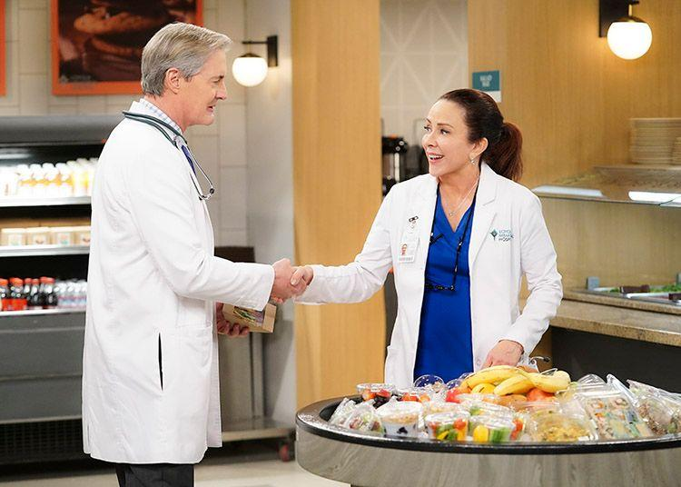 "Kyle MacLachlan and Patricia Heaton as doctors in CBS comedy ""Carol's Second Act."""