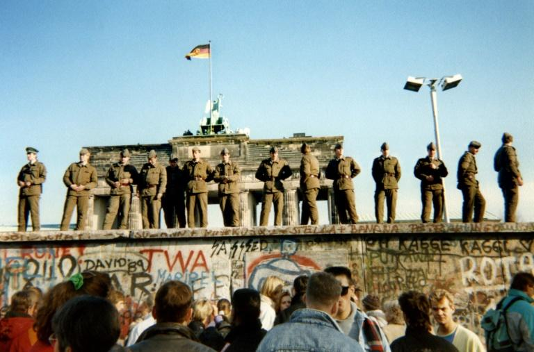 Three days after Schabowski's announcement, on November 11, crowds gathered at the wall as border guards watched