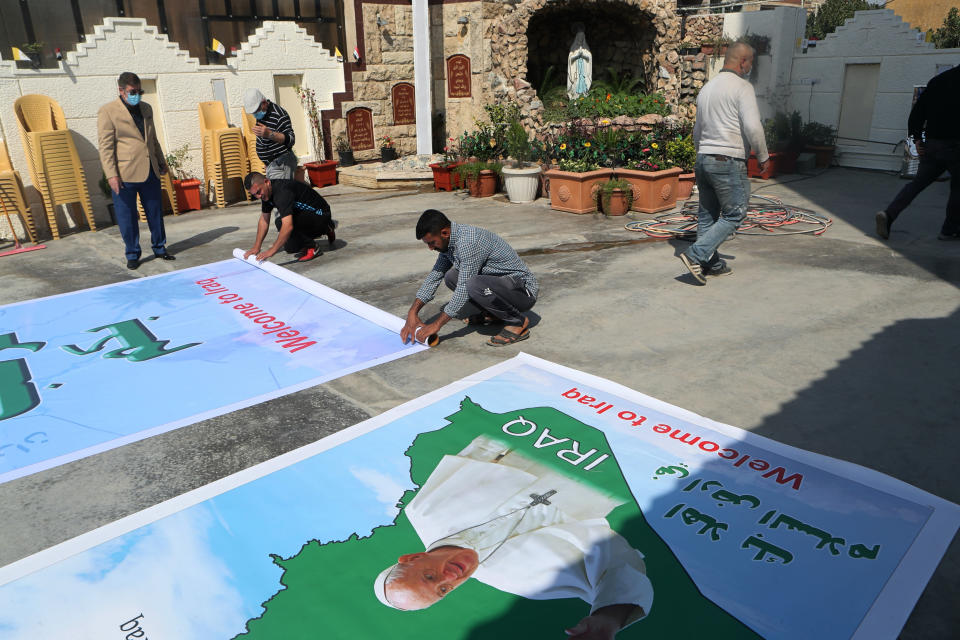 Iraq Christians prepare posters welcoming Pope Francis to St. Joseph's Chaldean Church ahead of the Pope's visit, in Baghdad, Iraq, Tuesday, March 2, 2021. (AP/Photo/Khalid Mohammed)