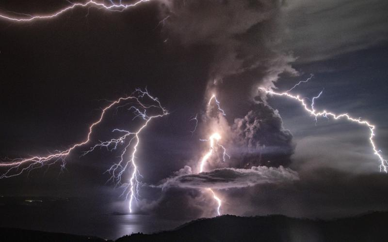 Taal's volcanic cloud has been lit up by spectacular lightening storms - Getty Images AsiaPac