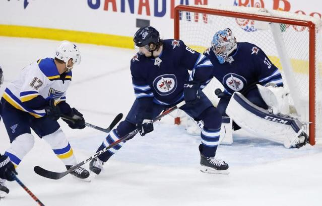 """WINNIPEG — Jaden Schwartz called it a lucky goal, but it was a dagger to the Winnipeg Jets.The St. Louis forward scored with 15 seconds remaining in the third period, lifting the Blues to a 3-2 victory over Winnipeg on Thursday and handing St. Louis a 3-2 series lead in their Western Conference quarterfinal.Tyler Bozak sent a pass over to Schwartz, who batted the puck in the air and sent it past Jets goalie Connor Hellebuyck for the winner.""""(Bozak) came on, he was fresh, and probably knew there wasn't much time left so he just threw (the puck) on net and I kind of got lucky, it just hit my stick,"""" Schwartz said of his first goal in the playoffs.Ryan O'Reilly and Brayden Schenn also scored for the Blues in the third period. St. Louis hosts Game 6 of the best-of-seven series on Saturday. Jordan Binnington stopped 29 shots for the visitors.Winnipeg was up 2-0 after first-period goals by Adam Lowry and Kevin Hayes.""""If we lose, we're done,"""" Hayes said. """"That's enough motivation. Game 6 will be our best game.""""According to a league stat, when a best-of-seven NHL playoff series is tied 2-2, the winner of Game 5 takes the series 78.8 per cent all time (205-55).All the games in the series have been won by the visiting team.""""You don't see that too often, right?"""" Blues captain Alex Pietrangelo said. """"You don't see the road team win all the games but, again, we've got to go home and we played better in Game 4 there so we've got to build off that.""""Hellebuyck made 26 saves for Winnipeg, which extended its home losing streak to six games, including the regular season.""""Lucky pinballs,"""" Hellebuyck said of Schwartz's goal. """"The puck just bounced and ended up right on their tape. Tough to eat that one, but I thought we were the better team. If we keep fighting here, it's not over.""""Schenn tied the game 2-2 with 6:08 remaining in the third period following a review. Oskar Sundqvist passed the puck over to Schenn and then slid into the net and knocked it off, but it was ruled Schenn had s"""