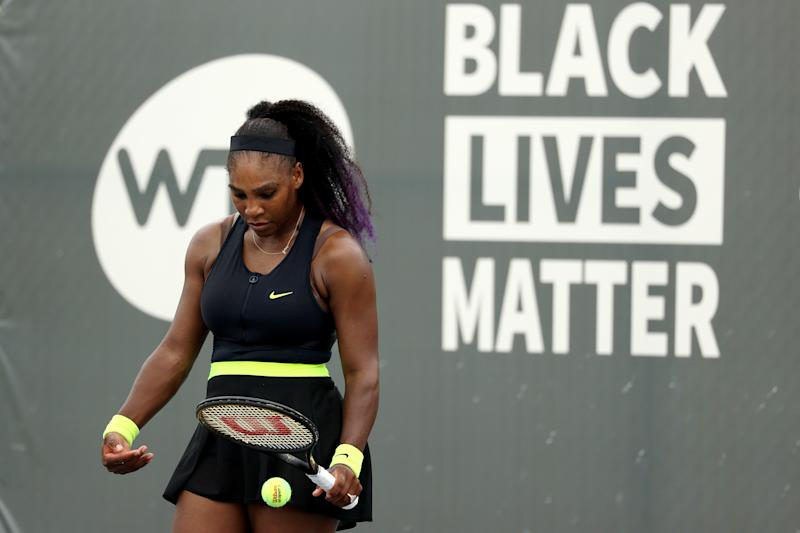Serena Williams prepares to serve during her match.