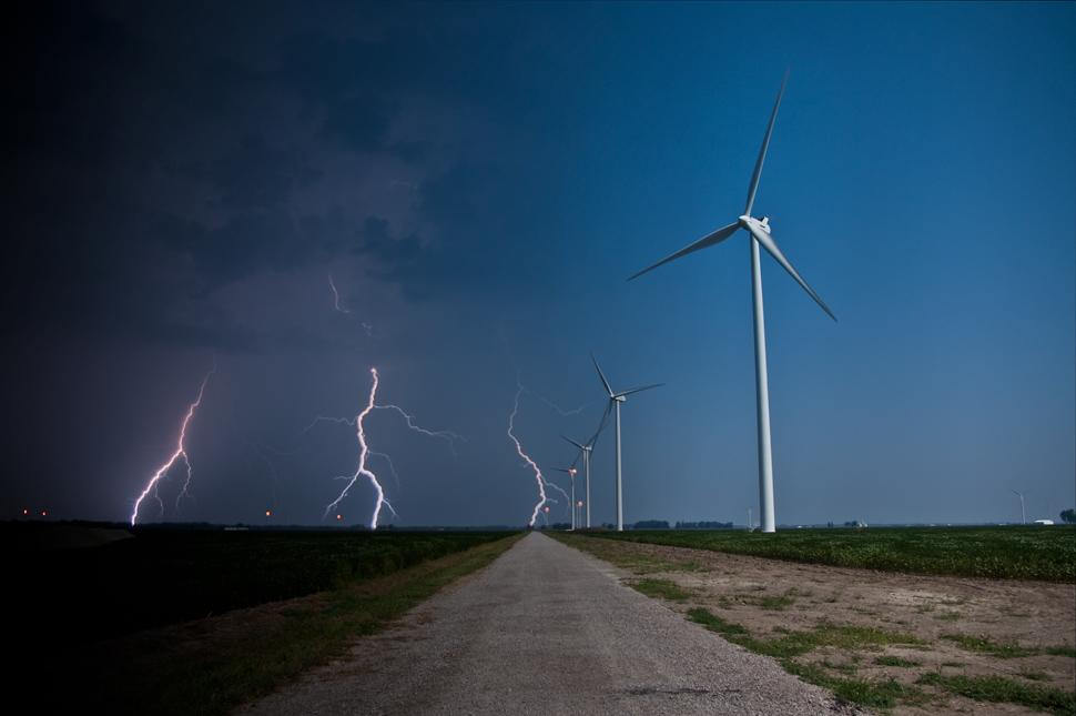 This wind farm was shot at 10:30am and 8:00pm.  The photographer happened to capture a nearby storm in the second shot.  (Photo: Chris DePrisco / Gizmodo.com)