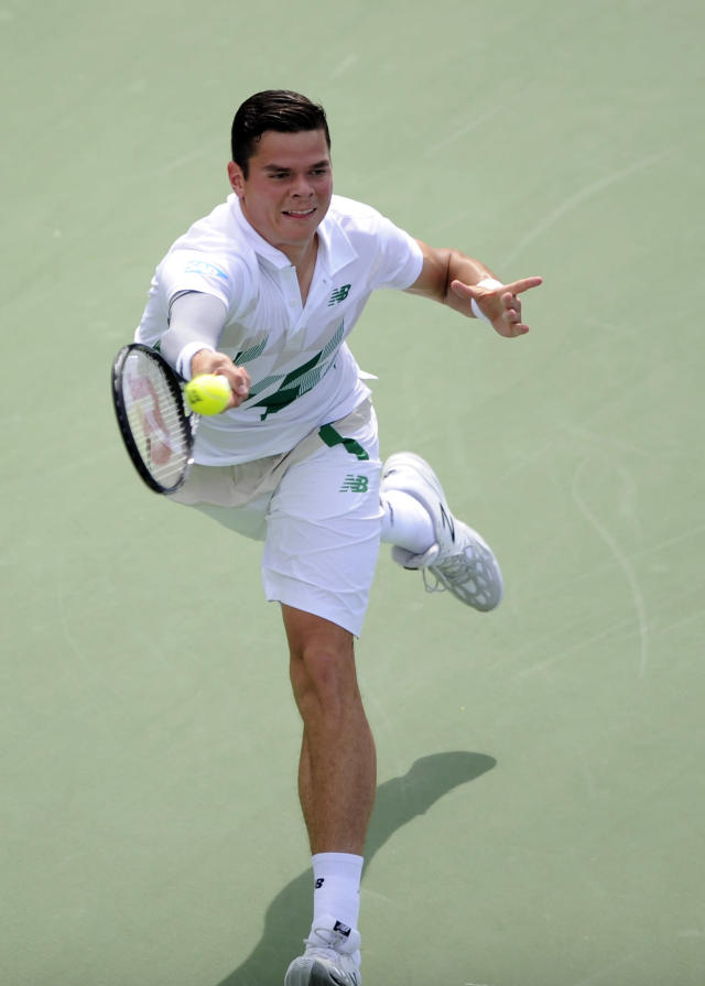 Milos Raonic, of Canada, returns a shot against Donald Young during a match at the Citi Open tennis tournament, Saturday, Aug. 2, 2014, in Washington. Raonic won 6-4, 7-5. (AP Photo/Nick Wass)