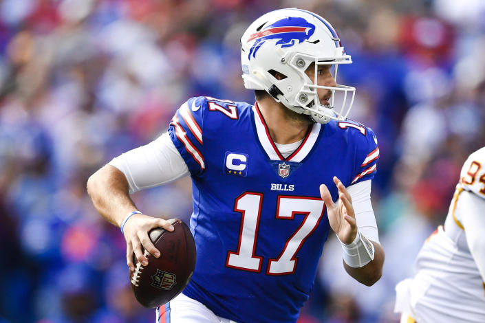 Buffalo Bills quarterback Josh Allen (17) looks to pass during the first half of an NFL football game against the Washington Football Team, Sunday, Sept. 26, 2021, in Orchard Park, N.Y. (AP Photo/Adrian Kraus)