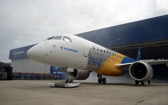 The first Embraer E190-E2 jet being rolled out.