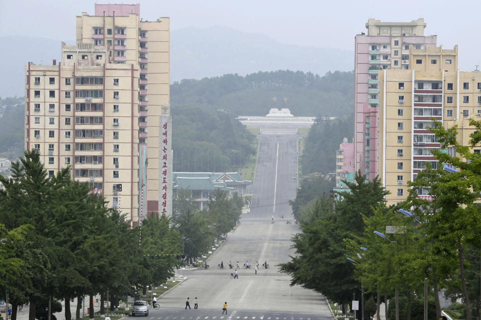 """People make their way in Kaesong, North Korea July 23, 2019. North Korean leader Kim Jong Un placed the city of Kaesong near the border with South Korea under total lockdown after a person was found there with suspected COVID-19 symptoms, saying """"the vicious virus"""" may have entered the country, state media reported Sunday, July 26, 2020. (Naohiko Hatta/Kyodo News via AP)"""