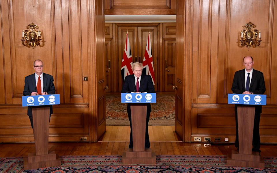 Chief scientific adviser Sir Patrick Vallance (left) and Chief Medical Officer Professor Chris Whitty (right), listen to Prime Minister Boris Johnson speaking during a news conference in response to the ongoing situation with the Covid-19 pandemic, at 10 Downing Street, London.