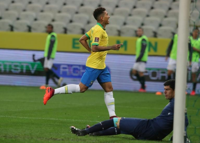 Liverpool forward Roberto Firmino celebrates his second goal as Brazil romped to victory against Bolivia