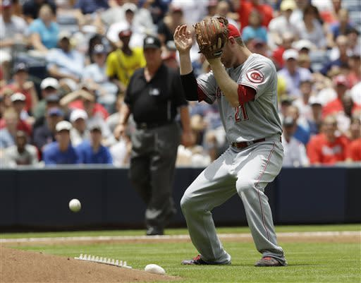 Cincinnati Reds third baseman Todd Frazier can't catch a fly ball by Atlanta Braves' Reed Johnson in the second inning of a baseball game, Sunday, July 14, 2013 in Atlanta. (AP Photo/John Bazemore)