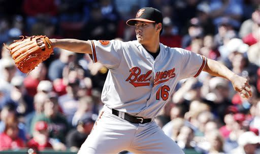 Baltimore Orioles starting pitcher Wei-Yin Chen of Taiwan delivers against the Boston Red Sox during the first inning of a baseball game at Fenway Park in Boston Monday, April 8, 2013. (AP Photo/Winslow Townson)