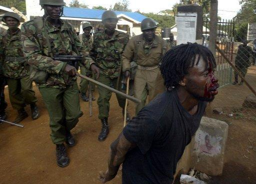 File photo shows a Kenyan demonstrator wounded after being beataen by anti-riot police in December 2007 at Kibera slum in Nairobi. The International Criminal Court has confirmed charges against four out of six Kenyan officials, who will now face trial over deadly post-election unrest four years ago in which 1,100 died