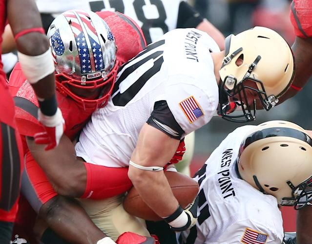 PISCATAWAY, NJ - NOVEMBER 10: Cody Jackson #10 of the Army Black Knights is tackled in the fourth quarter against the Rutgers Scarlet Knights on November 10, 2012 at High Point Solutions Stadium in Piscataway, New Jersey.The Rutgers Scarlet Knights defeated the Army Black Knights 28-7. (Photo by Elsa/Getty Images)
