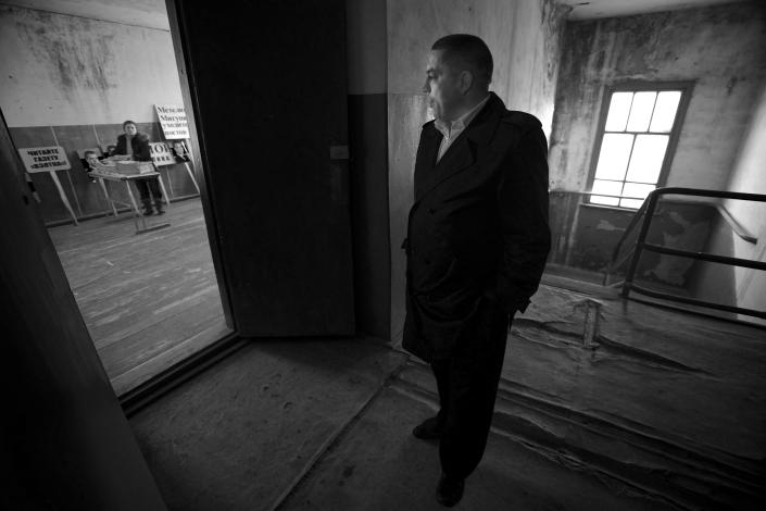 In this Nov. 14, 2012, photo, Eduard Mochalov, editor of The Bribe, stands in an abandoned barn where he keeps old copies of The Bribe and posters from protests against corruption in Chuvashia, in Yarabaikasy, near Cheboksary, the capital city of Chuvashia, Russia. Eduard Mochalov has found a new lease on life as a crusading journalist investigating corruption in his native region, fueled by tips from disgruntled businessmen and government workers. Undeterred by a system where the law is selectively used to protect the powerful and crack down on critics, Mochalov has quickly earned cult status _ not to mention the ire of countless local officials _ throughout the small province of Chuvashia. (AP Photo/Alexander Zemlianichenko)