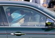<p>Wearing a turquoise hat with a purple flower, the Queen left the Queen's Cup polo tournament, driving her Jaguar out of the event. </p>