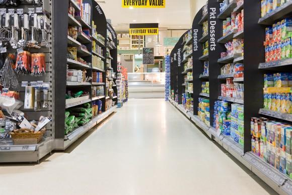 A retail store aisle with a variety of products in it.