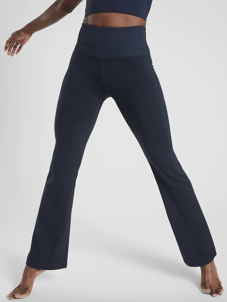 <p>The supportive high waistband on the <span>Athleta Studio Flare Pants</span> ($89) doubles as a pocket for storing cards and other essentials.</p>