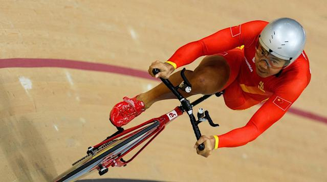 <p>Lian Guihua of CHina competes in the final of the Men's C1-2-3 1000m Time Trial in the Rio Olympic Velodrome at the Paralympic Games in Rio de Janeiro, Brazil.</p>