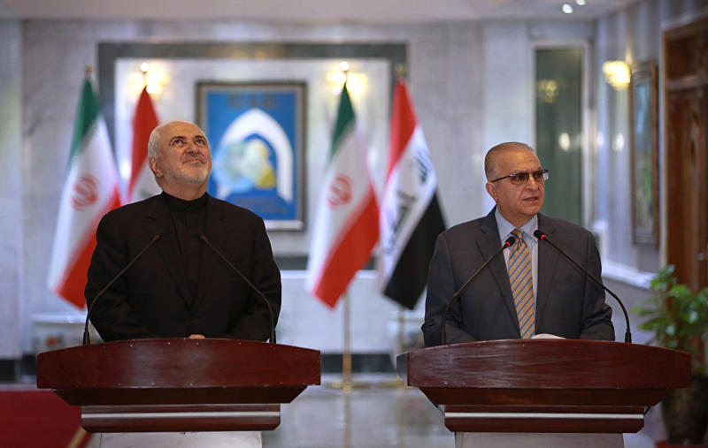 Iraqi Foreign Minister Mohamed Alhakim, right, holds a press conference with his visiting Iranian counterpart Mohammad Javad Zarif, at the Ministry of Foreign Affairs in Baghdad, Iraq, Sunday, May 26, 2019. (AP Photo/Khalid Mohammed)