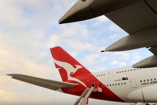 "A Qantas A380 Airbus is seen on the tarmac at Melbourne's Tullamarine Airport, in 2011. Australian marketing baron John Singleton said Wednesday he has ""always"" been interested in ailing Qantas but stopped short of confirming reports he is part of a consortium planning a takeover"