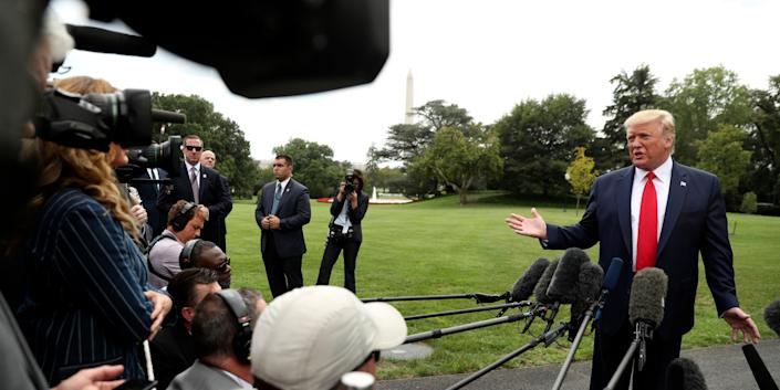 President Donald Trump speaks to members of the media on the South Lawn of the White House in Washington, Monday, Sept. 9, 2019, before boarding Marine One for a short trip to Andrews Air Force Base, Md., and then on to North Carolina. (AP Photo/Andrew Harnik)