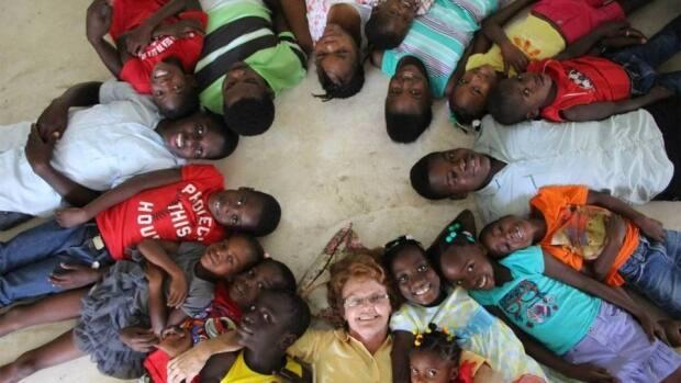 They call her 'Mama' and they're missing her right now. Karen Huxter of Springdale has been running a children's home and school in Deschapelles, Haiti, for about 20 years. (Submitted by Karen Huxter - image credit)