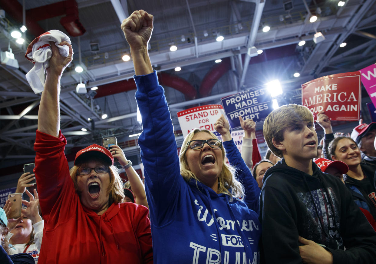 Trump supporters cheer as the president arrives to speak at the rally. (Photo: Carolyn Kaster/AP)