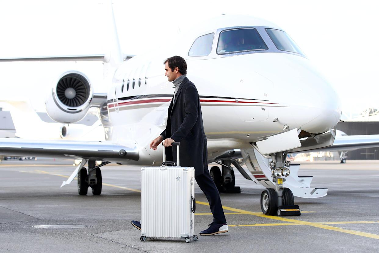 Roger Federer of Switzerland walks past the Netjets plane as he arrives ahead of the The Laver Cup Press Conference on February 08, 2019 in Geneva, Switzerland. (Photo by Julian Finney/Getty Images for The Laver Cup)