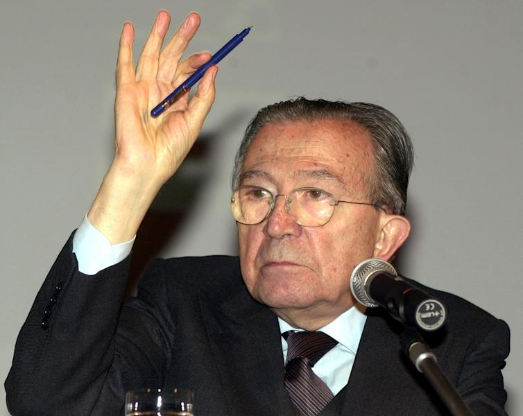 FILE - In this Dec. 8, 2001 file photo Italian life senator Giulio Andreotti gestures during a press conference. Italian state television says Giulio Andreotti, Italy's former seven-time premier, has died at age 94. At his prime, Andreotti was one of Italy's most powerful men: he helped draft the country's constitution after World War II, sat in parliament for 60 years and served as premier seven times. Andreotti was hospitalized last year with heart problems stemming from a respiratory infection. (AP Photo/Luca Bruno/Files)