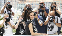 Marion Cotillard poses for photographers at the photo call for the film Annette at the 74th international film festival, Cannes, southern France, Tuesday, July 6, 2021. (Photo by Vianney Le Caer/Invision/AP)