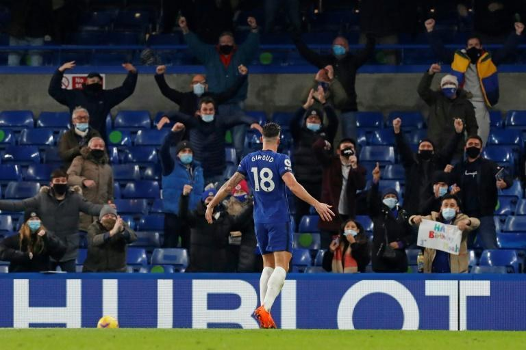 Olivier Giroud celebrates in front of the Chelsea fans, who were back at Stamford Bridge for the first time since March
