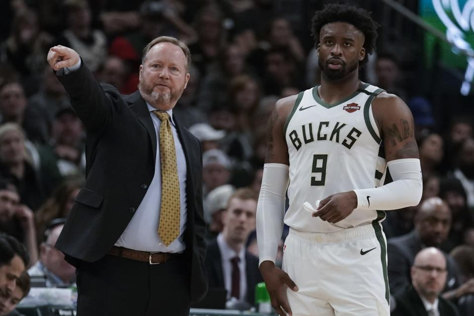 Milwaukee Bucks head coach Mike Budenholzer talks to Wesley Matthews during the first half of an NBA basketball game against the San Antonio Spurs Saturday, Jan. 4, 2020, in Milwaukee. (AP Photo/Morry Gash)