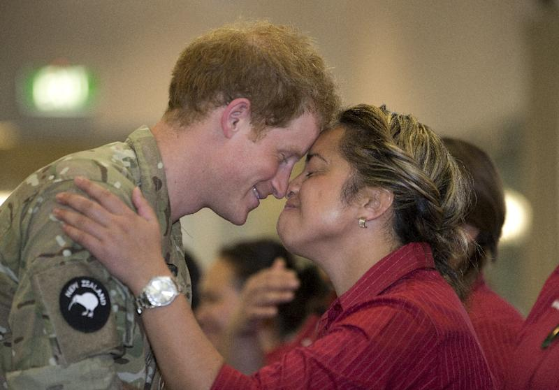 Britain's Prince Harry (L) receives a 'hongi', traditional Maori greeting, from a member of the Kairanga Kapa Hake group performer during a visit to Linton Military Camp near Palmerston North, on May 13, 2015 (AFP Photo/Mark Mitchell)