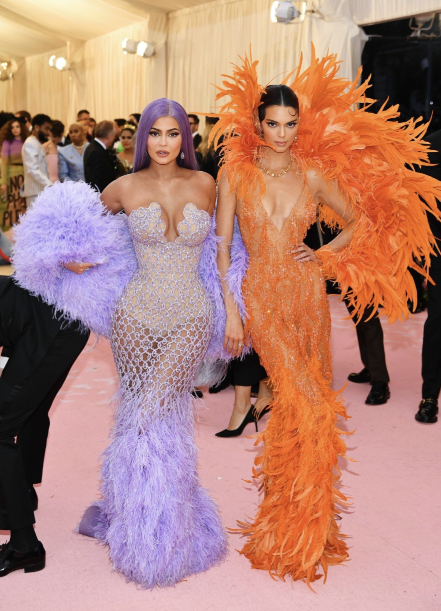Kylie and Kendall Jenner took this year's theme very seriously and arrived in showgirl-like outfits to fashion's night of nights. Photo: Getty Images