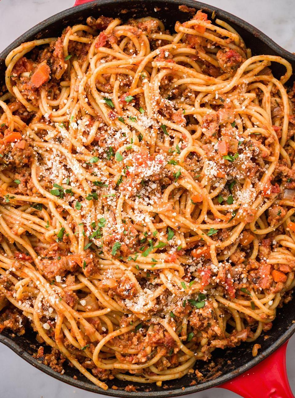 """<p>You know you just want to dig your fork in there and twirl it.</p><p>Get the recipe from <a href=""""https://www.redbookmag.com/cooking/recipe-ideas/recipes/a45776/spaghetti-with-turkey-ragu-recipe/"""" rel=""""nofollow noopener"""" target=""""_blank"""" data-ylk=""""slk:Delish"""" class=""""link rapid-noclick-resp"""">Delish</a>.</p><p><strong><a class=""""link rapid-noclick-resp"""" href=""""https://www.amazon.com/Creuset-Signature-Handle-Skillet-4-Inch/dp/B00B4UOTBQ/?tag=syn-yahoo-20&ascsubtag=%5Bartid%7C10063.g.34933194%5Bsrc%7Cyahoo-us"""" rel=""""nofollow noopener"""" target=""""_blank"""" data-ylk=""""slk:BUY NOW"""">BUY NOW</a><em> Le Creuset Cast-Iron 12"""" Skillet, $200, amazon.com</em></strong><br></p>"""