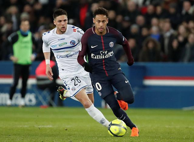 Soccer Football - Ligue 1 - Paris St Germain vs RC Strasbourg - Parc des Princes, Paris, France - February 17, 2018 Paris Saint-Germain's Neymar in action with Strasbourg's Jonas Martin REUTERS/Benoit Tessier