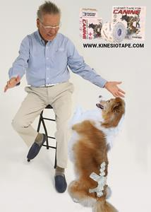 Dr. Kenzo Kase, inventor of elastic therapeutic taping and Founder of Kinesio with a furry friend