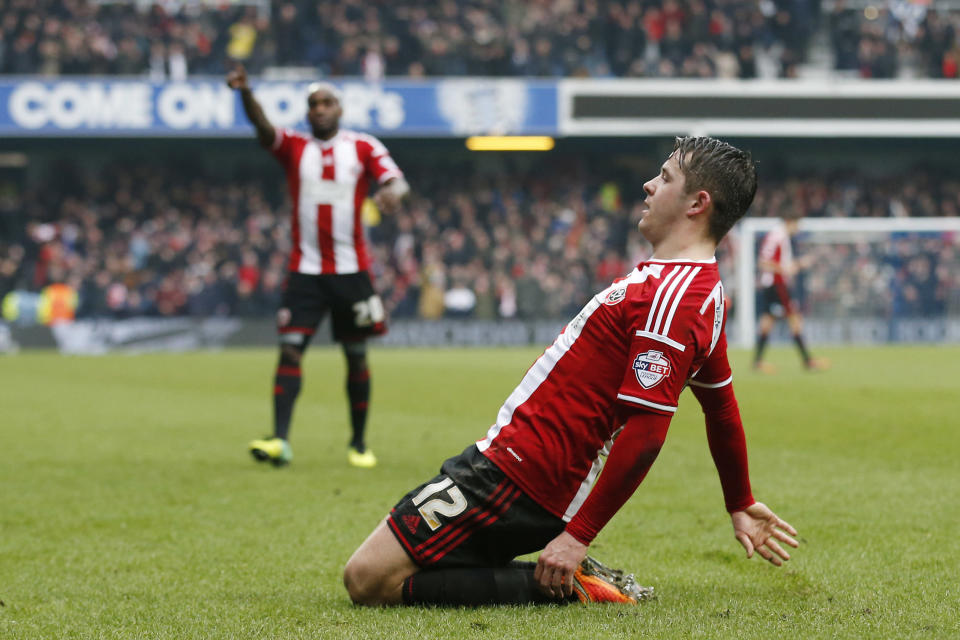 Marc McNulty celebrates after scoring the opening goal in Sheffield United's 3-0 FA Cup victory over Queens Park Rangers at Loftus Road on January 4, 2015 (AFP Photo/Justin Tallis)