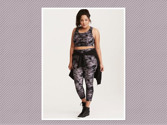 "<p>Cool In Camo Active Leggings, $55 (on sale $33), and Sports Bra, $39 (on sale $24), <a href=""https://www.torrid.com/product/cool-in-camo-active-set/TD_ACTIVE+SM1+10839540_10839548.html#q=camo&start=14"" rel=""nofollow noopener"" target=""_blank"" data-ylk=""slk:Torrid"" class=""link rapid-noclick-resp"">Torrid</a> (Photo: Torrid) </p>"