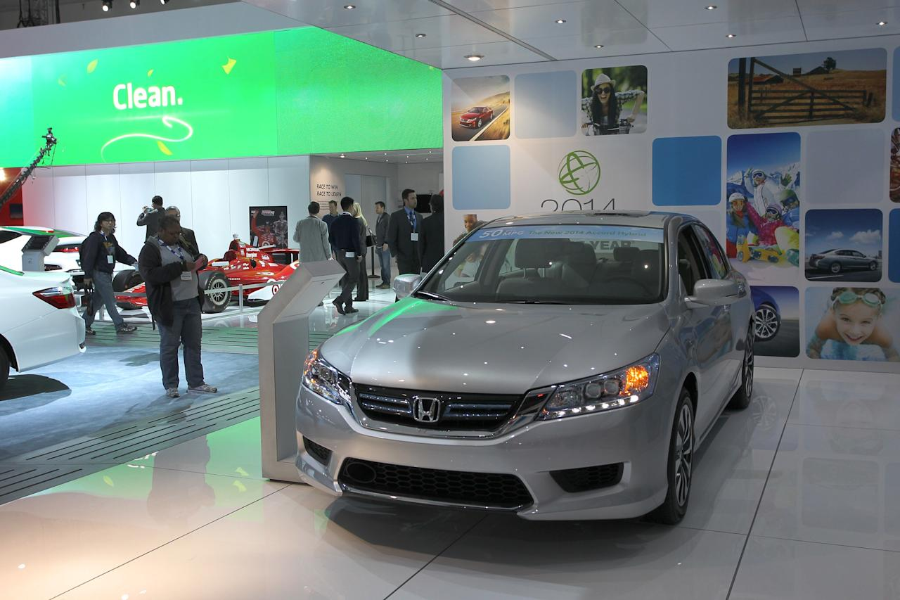 LOS ANGELES, CA - NOVEMBER 21: A Green Car of the Year award winning 2014 Honda Accord Hybrid is displayed at the 2013 Los Angeles Auto Show on November 21, 2013 in Los Angeles, California. The LA Auto Show was founded in 1907 and is one of the largest with more than 20 world debuts expected. The show will be open to the public November 22 through December 1. (Photo by David McNew/Getty Images)